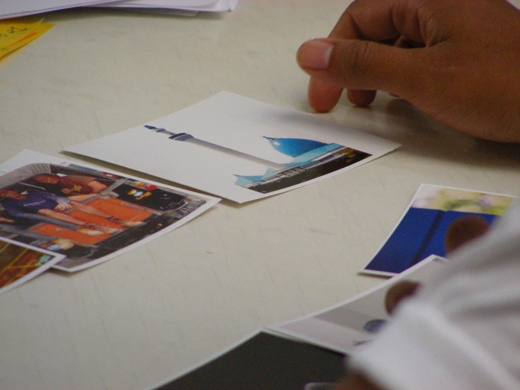 a participant chooses photos from a set of cards