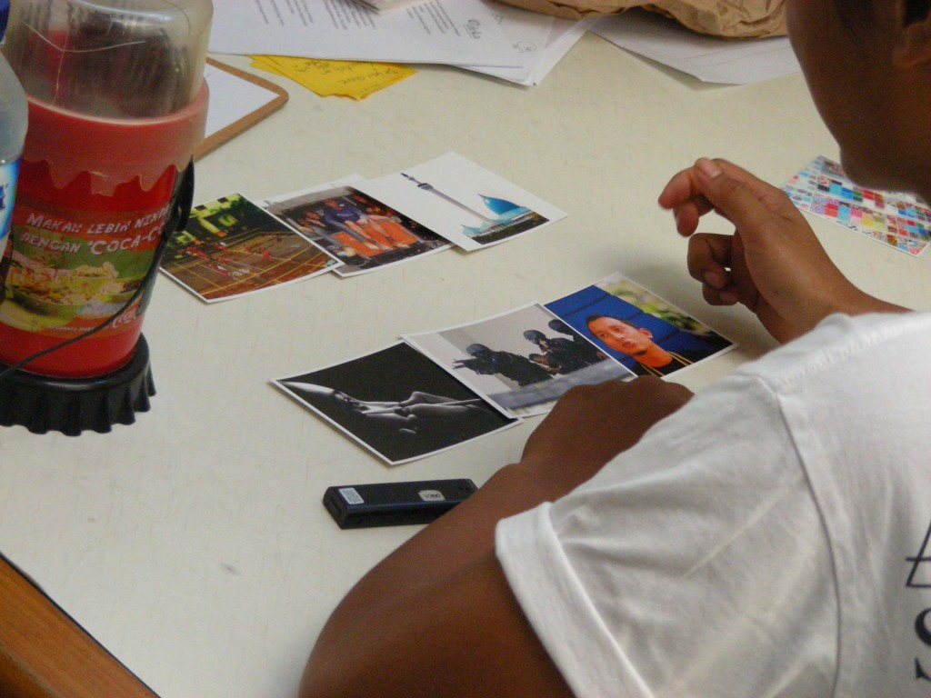 A participant chooses 6 photo cards to describe her communication experiences.